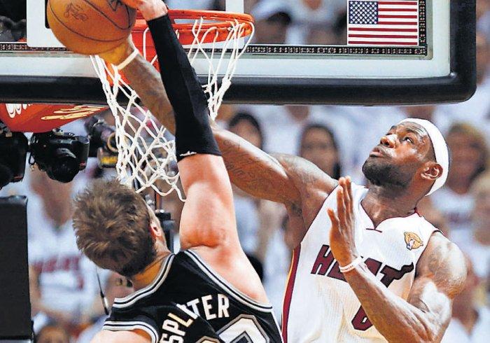 Heat overwhelm listless Spurs