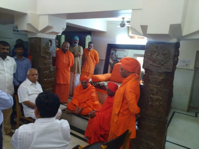 """Speaking to reporters after visiting Swami, Yeddyurappa said, """"It has been decided not to give him too much medication. He is able to see people who visit him and now it is for him to decide about the medication. The seer is still in the same health condition."""""""