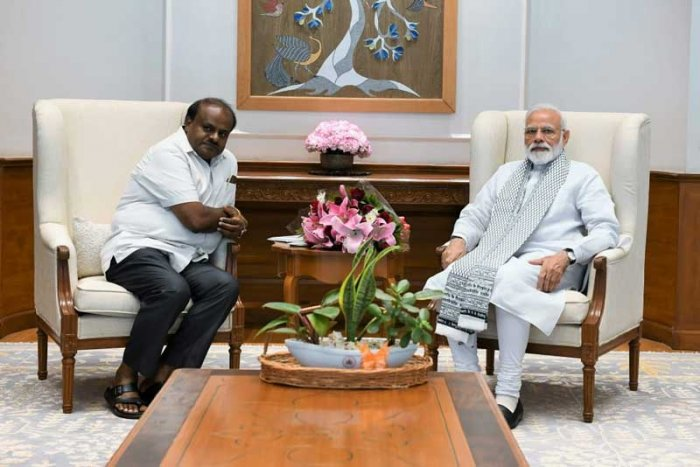 Karnataka Chief Minister H D Kumaraswamy met Prime Minister Narendra Modi in Delhi on Saturday and sought funds to take up relief works in drought hit areas.
