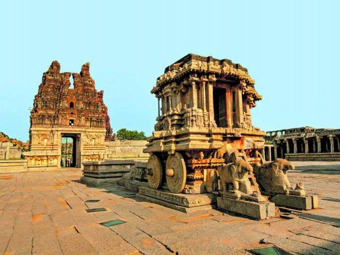 Chariot and Vittala temple at UNESCO heritage site Hampi in Karnataka, India. Getty image.
