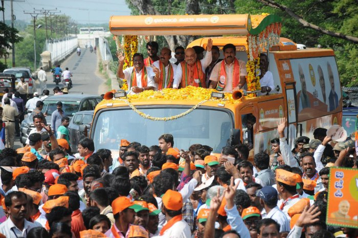 BJP National President Amit Shah on a roadshow. DH HOTOS