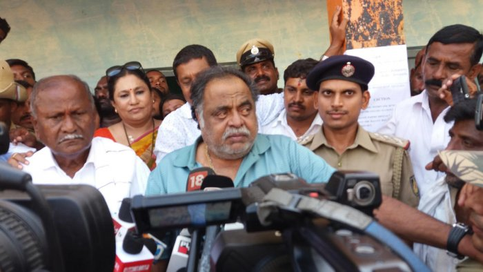Former minister M H Ambareesh speaks to reporters after voting at Doddarasinakere village, near Bharathinagar, Mandya district, on Saturday.