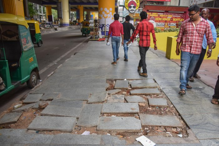 A broken footpath near the Indiranagar metro station. DH PHOTO/SK DINESH