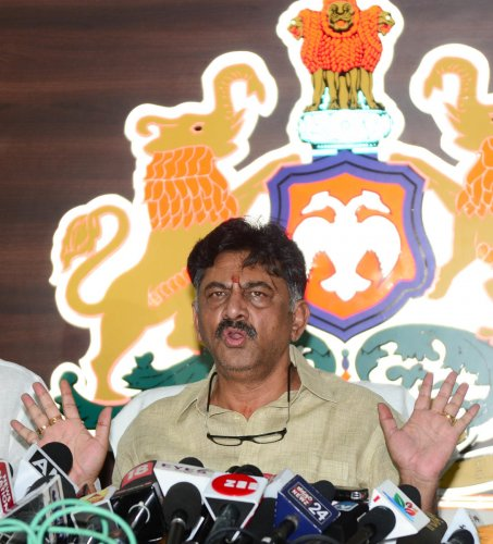 Water Resources and Medical Education Minister D K Shivakumar addresses a press meet at his residence inBengaluru on Wednesday. DH PHOTO