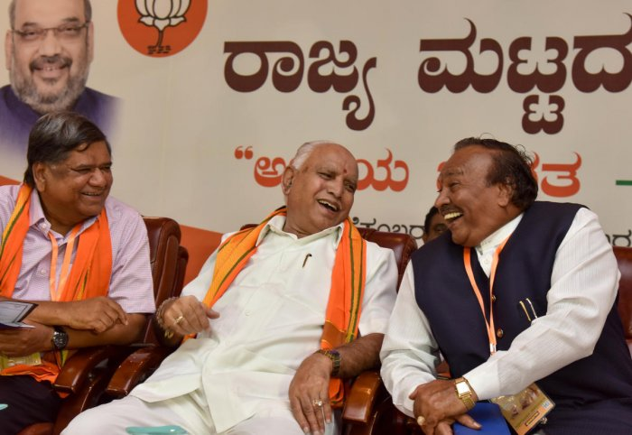 BJP state president B S Yeddurappa shares a light moment with party leaders K S Eshwarappa and Jagadish Shettar at a party meeting in Bengaluru on Wednesday. DH photo
