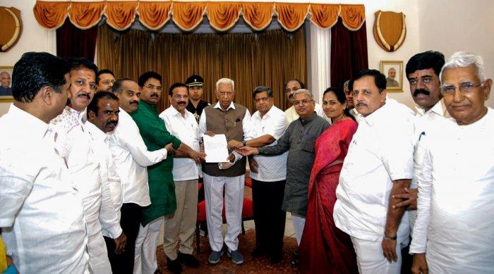 A BJP delegation, led by Union Minister D V Sadananda Gowda, submits a memorandum to Governor Vajubhai Vala seeking action against Chief Minister H D Kumaraswamy, at Raj Bhavan in Bengaluru on Friday.