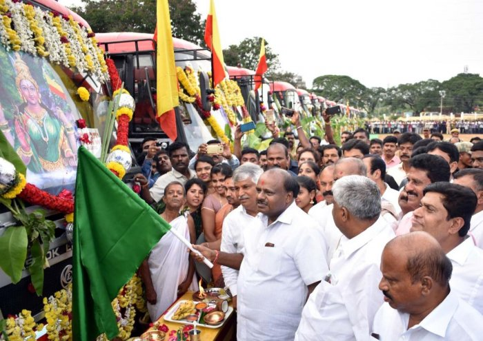 Chief Minister H D Kumaraswamy flags off 20 new buses, in Mandya, on Wednesday.