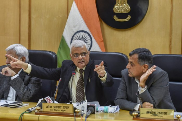 Chief Election Commissioner OP Rawat flanked by Election Commissioners Sunil Arora (L) and Ashok Lavasa (R) address a press conference to announce the dates for Assembly elections in five states, in Delhi, on Saturday. PTI