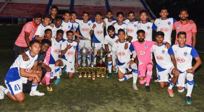 All SMILES: Bengaluru FC 'B' champions of the C Puttaiah Memorial Trophy. (From left) STANDING: Prashanth Kalinga, Biswa Darjee, Leon Augustine, Naushad Moosa (head coach), Ajay Chhetri, Roshan Singh, Parag Shrivas, Lalhmunmawia, Asheer Akthar, Lalengzama