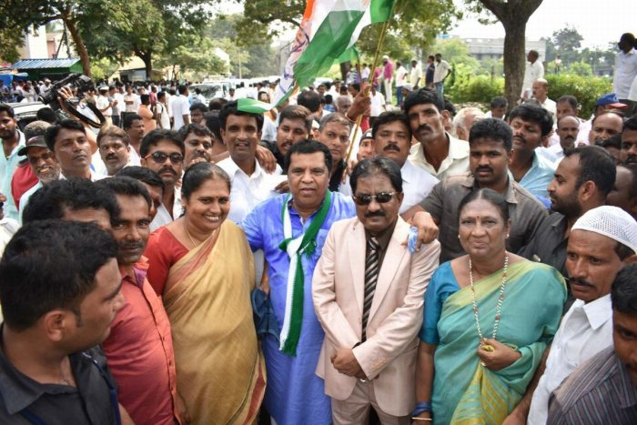 JD(S)-Congress coalition candidate L R Shivaramegowda arrives in a procession to file his nomination papers for the Lok Sabha by-elections in Mandya on Monday.