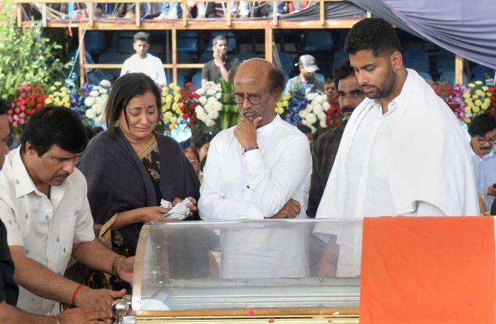 Actor Rajnikanth offers condolences to wife Sumalatha Ambarish and son Abhishek of veteran Kannada actor and politician Ambarish, who passed away in Bengaluru yesterday, at the age of 66, in Bengaluru, Sunday, Nov. 25, 2018. (PTI Photo/Shailendra Bhojak)