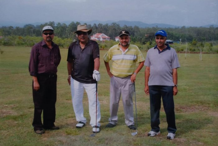 A file photo of Ambareesh with Golf Club president A B Sudarshan in Chikkamagaluru.