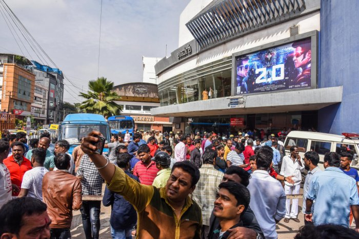 People are seen in front of Urvashi theater for seen Rajanikanth film 2.0 in Bengaluru on Thursday. DH Photo /S K Dinesh