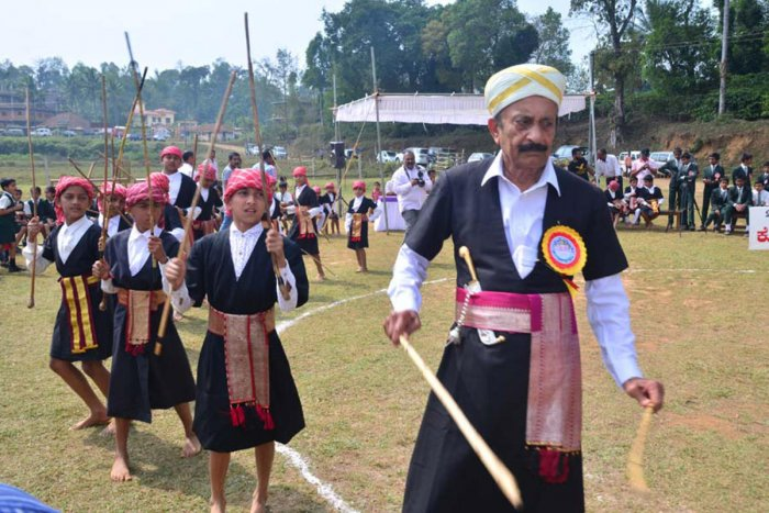 Former minister M C Nanaiah inaugurates the Kodava children's folk and cultural festival in Napoklu on Thursday, by dancing to the tune of Kodava traditional music.