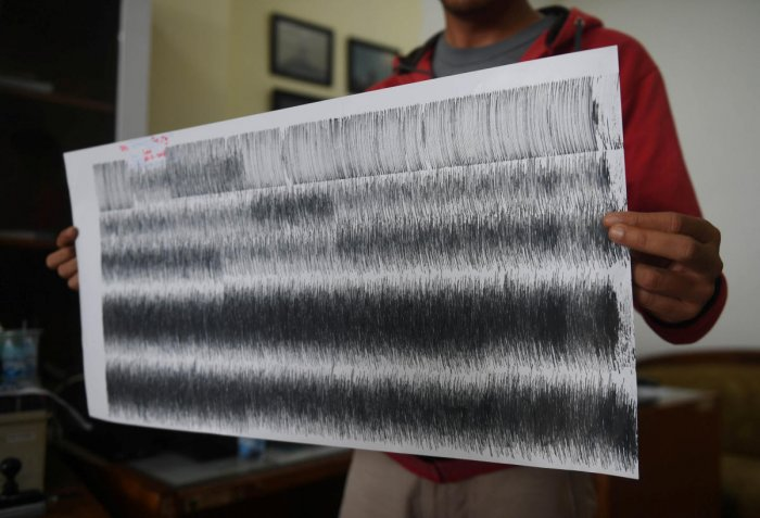 An officer shows seismograph results of Mount Anak Krakatau volcano, moments before a tsunami hit Sunda strait, at Pasauran in Serang, Banten province, Indonesia, December 25, 2018 in this photo taken by Antara Foto. (Antara Foto/Akbar Nugroho Gumay/via R