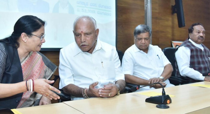 HEADS TOGETHER: (From left) BJP Karnataka Election co-in-charge Kiran Maheshwari, party state president B S Yeddyurappa, leaders Jagadish Shettar and K S Eshwarappa during the BJP Legislature Party meeting at its office in Bengaluru on Tuesday. DH Photo/J