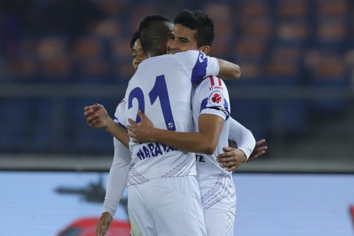 Delhi Dynamos FC players celebrate their first goal against Bengaluru FC on Sunday. ISL media