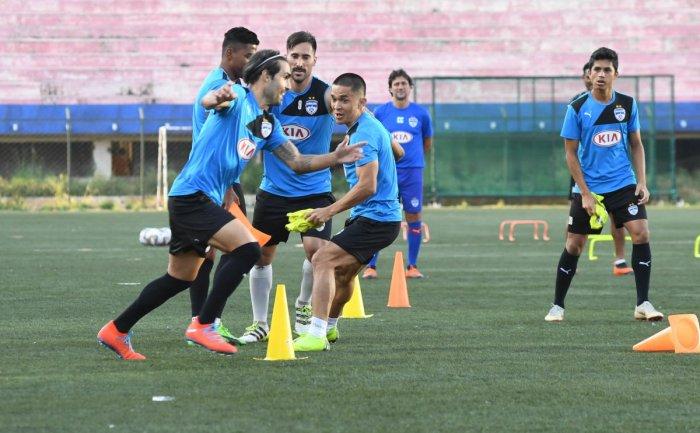fun time: BFC players train at the Bangalore Football stadium on the eve of their clash against FC Goa. DH Photo/ B H Shivakumar