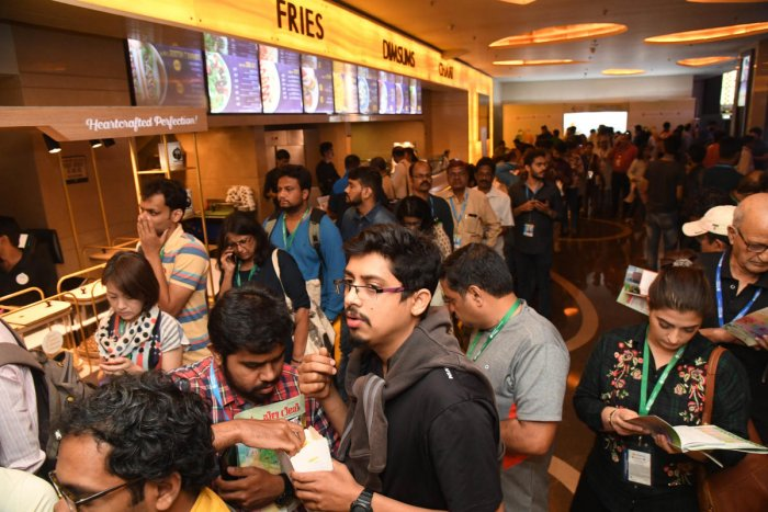 Film buffs line up to get tickets on the first day of the Bengaluru International Film Festival at the Orion Mall on Friday. DH PHOTO/B H Shivakumar