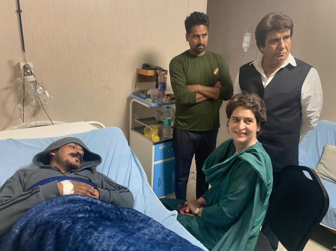 Congress general secretary Priyanka Gandhi Vadra visits Bhim Army chief Chandrashekhar Azad at a hospital, in Meerut on March 13. PTI