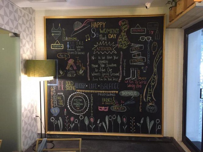 A blackboard at the entrance announces the theme for the month.