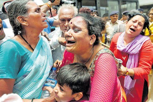 Two women, who lost their sons in the Gulberg Society massacre during the 2002 post-Godhra riots, have moved the Gujarat High Court seeking afree copy of documents related to the case as they can't afford to pay fortheir photocopies. Reuters file photo for representation only