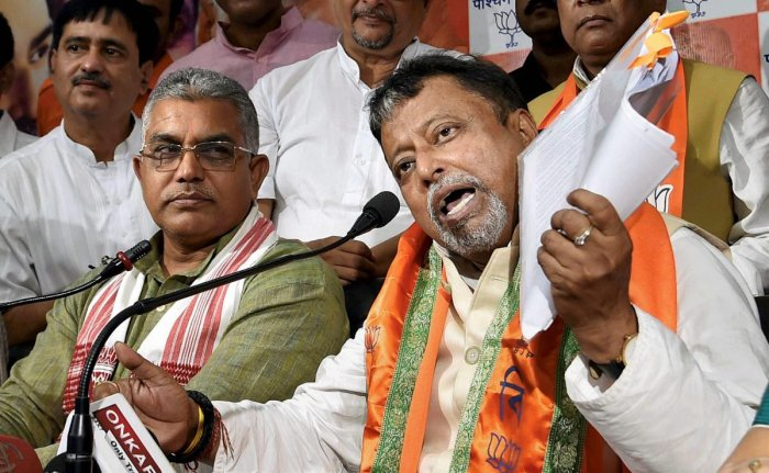 West Bengal BJP President Dilip Ghosh (L) and BJP leader Mukul Roy. PTI file photo