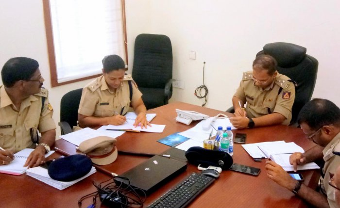Mangaluru City Police Commissioner Sandeep Patil attends to phone calls during the weekly phone-in programme at the Police Commissionerate in Mangaluru.