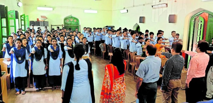 Students are administered oath on exercising franchise as a part of the awareness programme at University College in Mangaluru on Friday.