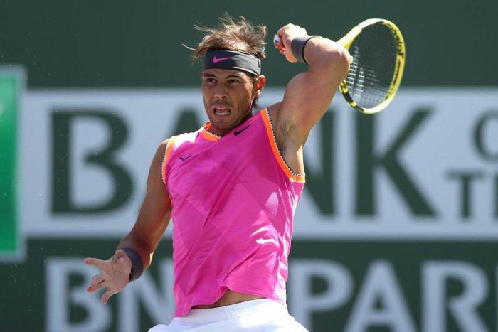 BATTLING WIN: Rafael Nadal of Spain returns during his quarterfinal win over Karen Khachanov of Russia. AFP