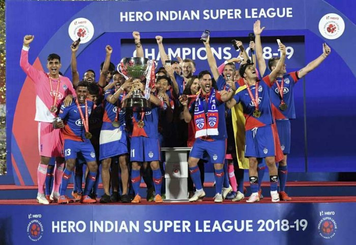 BLUES ARE THE BEST: Bengaluru FC players celebrate with the trophy after beating FC Goa FC in the ISL final in Mumbai on Sunday. BFC won 1-0 for the maiden title. PTI