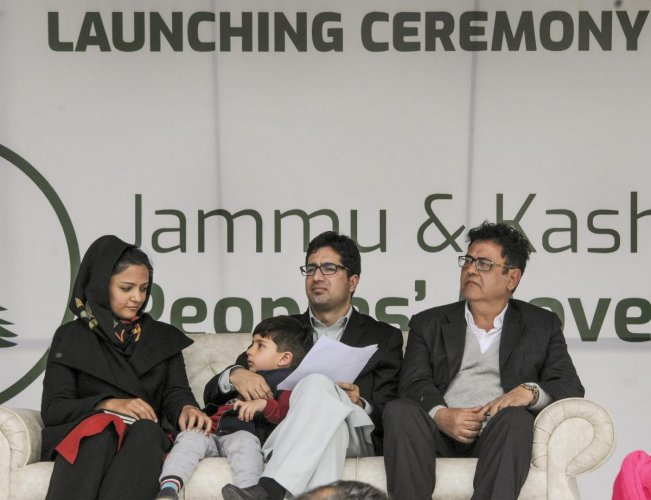 Former IAS officer Shah Faesal (C) with former JNU student leader and activist Shehla Rashid during a rally organised to launch a new political party 'Jammu and Kashmir Peoples' Movement', in Srinagar on Sunday. PTI photo