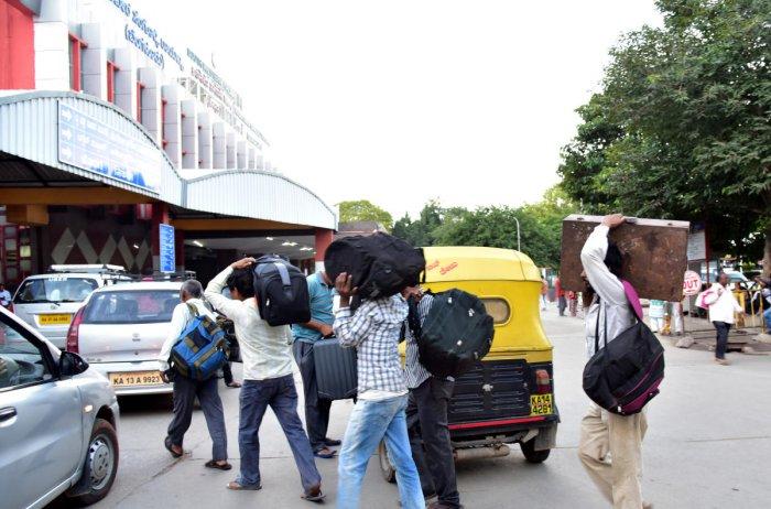 Passengers are seen at the KSR City Railway station, in Bengaluru. Photo/ B H Shivakumar