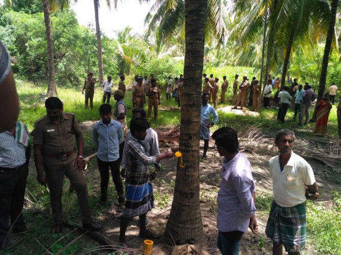 File photo of demarcation of boundaries for the Salem-Chennai Expressway being done in a farm land in Salem district, with police protection.