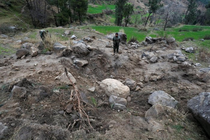 Pakistan's army soldier stands at the edge of a crater, after Indian military aircrafts struck on February 26, according to Pakistani officials, in Jaba village, near Balakot. Reuters photo