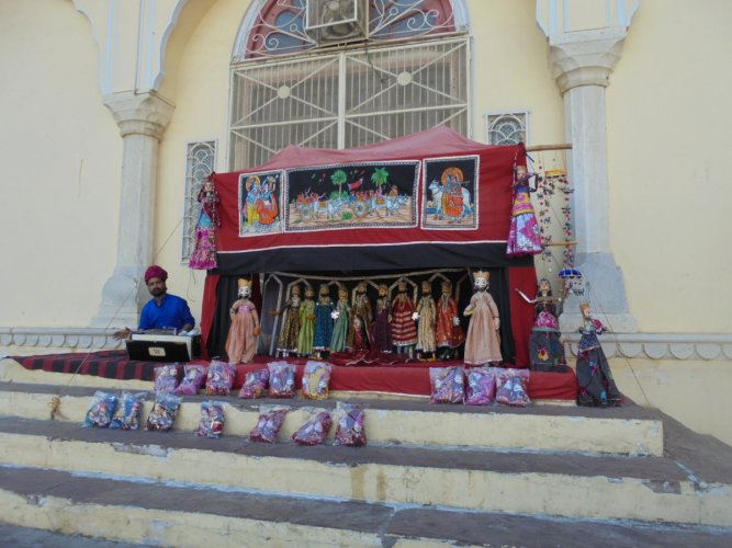 The show is on: A street puppeteer; (below) an exhibit in the Folk Art Museum, Udaipur. Photos by author