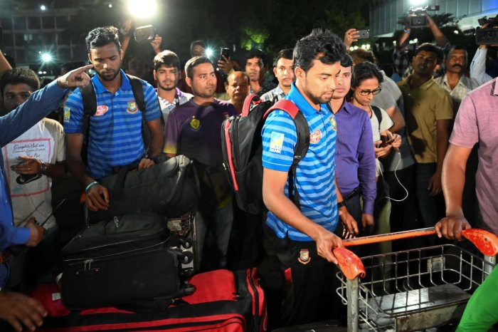 BACK HOME: Bangladesh cricketers arrive at the Dhaka airport from New Zealand on Saturday. AFP