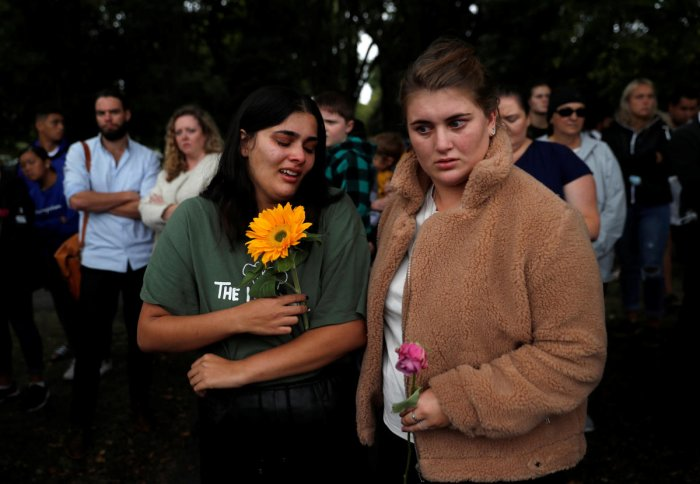 People react near Masjid Al Noor mosque in Christchurch, New Zealand, March 17, 2019. REUTERS