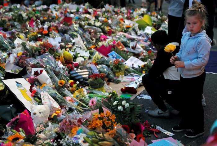 People visit a memorial site for victims of Friday's shooting, in front of the Masjid Al Noor mosque in Christchurch, New Zealand March 18, 2019. REUTERS