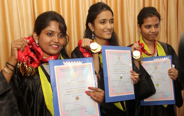 (From left) N Suchitra (nine gold medals), Meghana Prakash and Madhushri (six golds each) proudly display their medals and merit certificates at the 18th convocation of Visvesvaraya Technological University in Belagavi on Monday. DH PHOTO