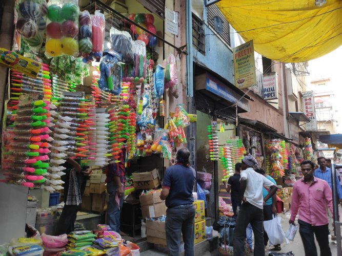 Old Tharagupete Street is buzzing with shoppers for Holi (Kamana Habba).