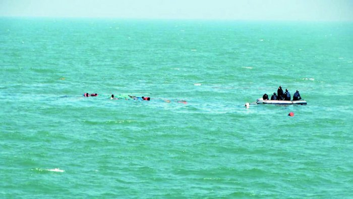 Six drowning crew from a sunken Tug, Revti, being rescued by Indian Coast Guard Ship Amartya on Monday.