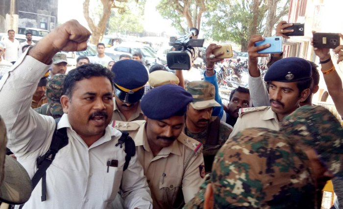Roopesh being brought to the District Principal and Sessions Court in Madikeri on Tuesday.