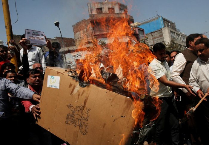 Traders burn Chinese products during a protest against, what they say, China preventing UN Security Council committee from blacklisting Masood Azhar the head of Pakistan-based militant group JeM, in New Delhi. PTI Photo