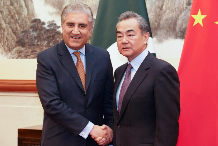 Chinese Foreign Minister Wang Yi shakes hands with Pakistani Foreign Minister Shah Mehmood Qureshi during a meeting at Diaoyutai State Guesthouse in Beijing, China. Reuters photo