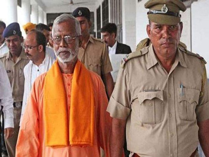 The special NIA court in Panchkula near here this evening acquitted former RSS activist Swami Aseemanand and three others in the Samjhauta Express blast case. (Image courtesy Twitter)