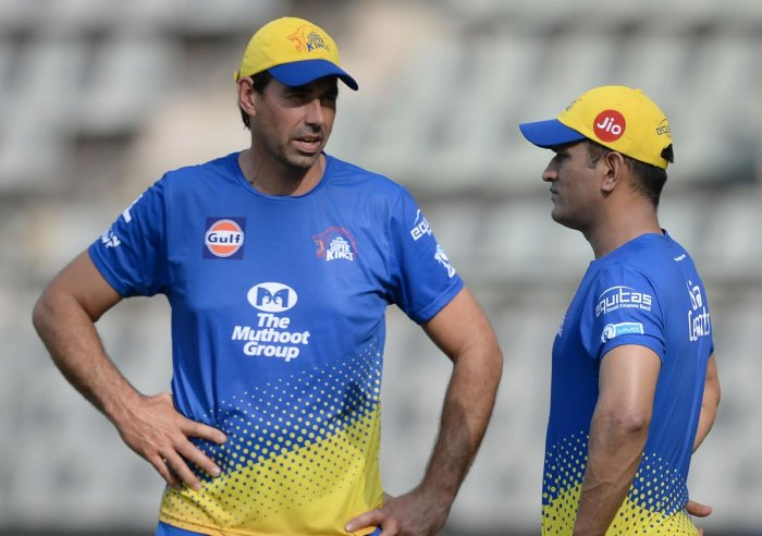 CSK captain M S Dhoni (right) will bat at No 4 but will be flexible also, says coach Stephen Fleming. AFP