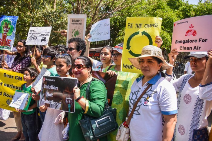 Citizens groups protested against the proposed road at the Mourya Hotel Circle on Saturday. DH photo by S K Dinesh