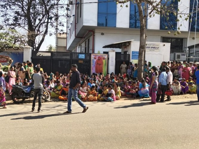Nearly 200 women workers of a garment factory in Peenya protested against its general manager and his subordinates who assaulted their 36-year-old co-worker.(DH Photo)