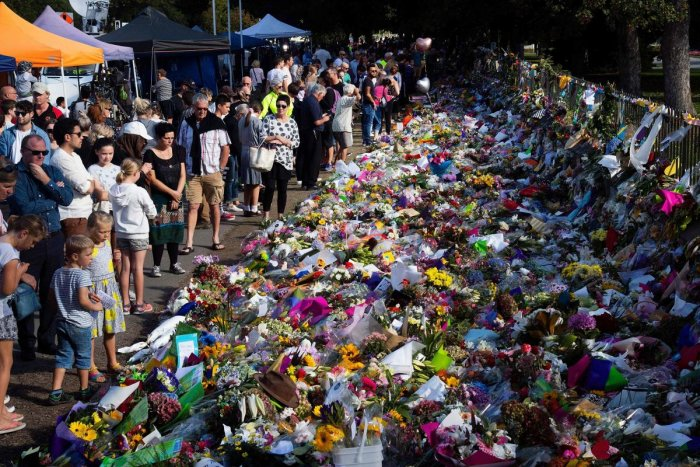 People pay tributes to those gunned down in Christchurch, NZ, on March 15.